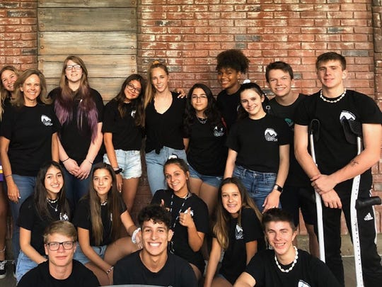 The Shadow Rock Student Ministries leaders ship team is all smiles after a recent conference. The group has used their off time from school to reach out to the elderly members of the church to see if they need any help.