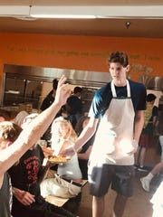 Josh Wallace, one of the student leaders at Shadow Rock chuck in La Quinta, helps serve food at the Coachella Valley Rescue Mission in 2019. Recently, the youth ministry has had to be more creative with their service due to the coronavirus.