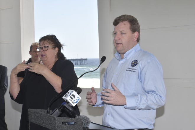 District 4 Commissioner Robert Bender holds a press conference at Pensacola Beach on Thursday, March 19, 2020, to announce that Pensacola Beach will remain open, but hotel capacity will be reduced to 50%.