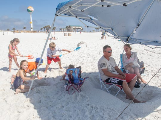 The Wagoner family, of Harrison, Arkansas, enjoys the day at Casino Beach in Pensacola on Thursday, March 19, 2020.