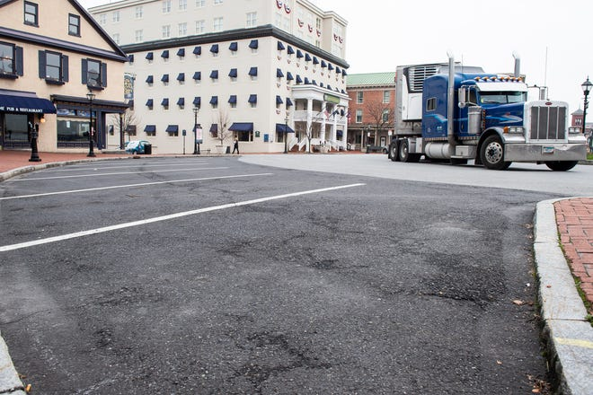 Many parking spots sit empty on the Lincoln Square in Gettysburg as non-essential businesses continue to be closed and restaurants offer take-out and delivery options on Thursday, March 19, 2020.