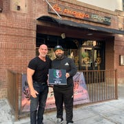 Mike Snitz, left, and restaurateur Justin Piazza stand outside La Piazza PHX in downtown Phoenix.