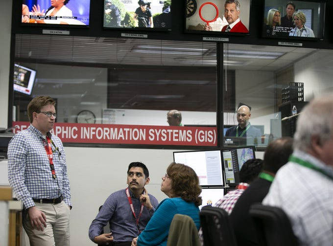 Members of  the State of Arizona Department of Emergency and Military Affairs (DEMA) work responding to the coronavirus pandemic, in the DEMA operations center at the Arizona National Guard Papago Park Military Reservation in Phoenix on March 18, 2020.