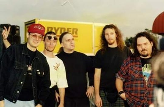 Sacred Reich with KUPD-FM on-air personality Larry Mac at a Tower Records appearance in the Valley in the early '90s. Jason Rainey is on the far right.