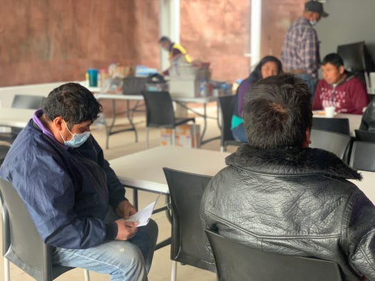 Migrants eating at the Kino Border Initiative's dining hall in Nogales, Sonora, wear face masks as a precaution against the new coronavirus on March 18, 2020.