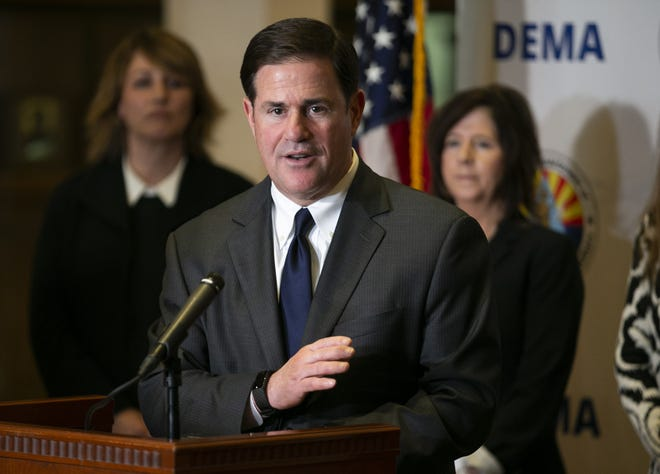 Arizona governor Doug Ducey, speaks about the latest information on the coronavirus pandemic in Arizona during a press conference at the Arizona National Guard Papago Park Military Reservation in Phoenix on March 18, 2020.