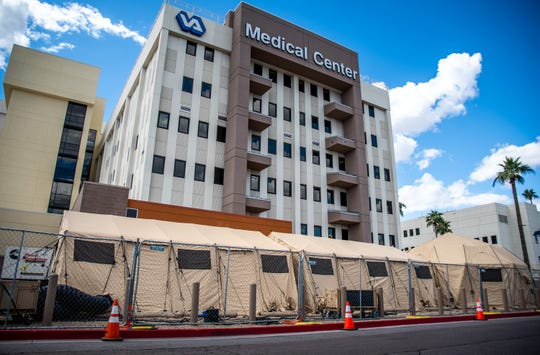 A tent for extra hospital beds is pictured at the Phoenix VA on March 19, 2020, in Phoenix.