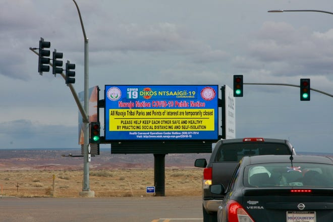 A sign on Navajo Nation land, after President Jonathan Nez closed access and limited services in the area.