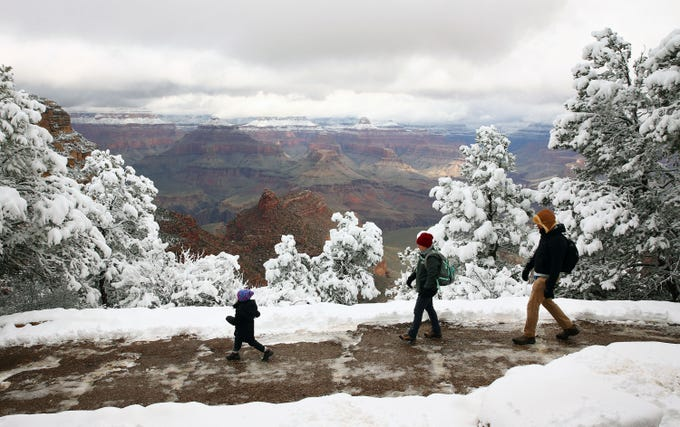 A snow storm on the first day of spring hits Grand Canyon National Park in Arizona on March 19, 2020. Due to the coronavirus health emergency, hotels and services are closing but the park remains open on Thursday.