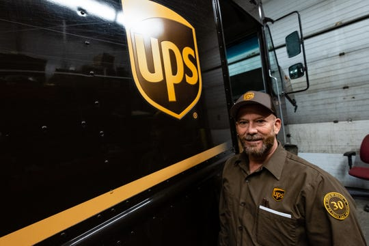 Ron Mackensen, a delivery driver for UPS, poses for a photo Thursday, March 19, 2020, at the UPS Distribution Center in Port Huron. Mackensen will be accident-free for 30 years in July.