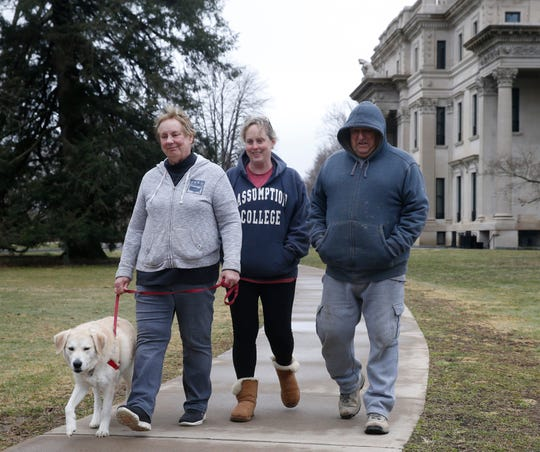 From left, Carol Colwell, Susan Christopher and Ed Christopher take a hike at Vanderbilt Mansion National Historic Site in Hyde Park on March 19, 2020.
