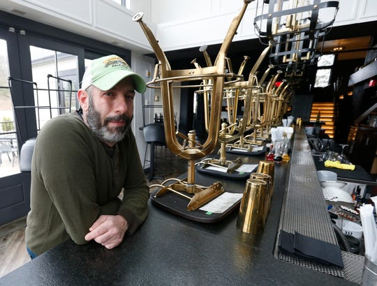 Heritage Food and Drink's bartender Rob Accordino sits at the restaurant's empty bar in Wappingers Falls on March 19, 2020.