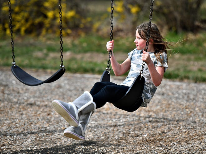 Children play at Fayfield Park in Springettsbury Township, Wednesday, March 18, 2020. Dawn J. Sagert photo