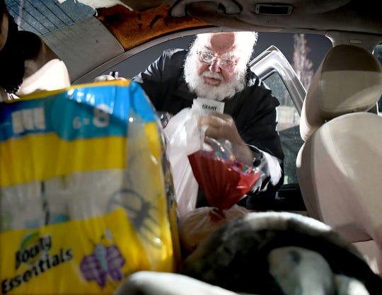Richard Luman of Stoverstown loads his car after shopping at the Giant at 1255 Carlisle Road during an hour reserved for only those aged 60 and older Thursday, March 19, 2020. The first hour of the store's day allows seniors to shop in less crowded conditions, providing a more sanitary setting for those susceptible to increased COVID-19 risks. Bill Kalina photo