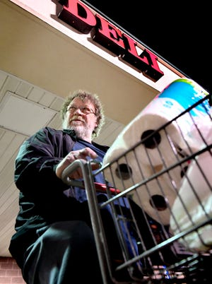 Dan Myers of Thomasville leaves the Giant at 1255 Carlisle Road after shopping during an hour reserved for only those aged 60 and older Thursday, March 19, 2020. The first hour of the store's day allows seniors to shop in less crowded conditions, providing a more sanitary setting for those susceptible to increased COVID-19 risks. Bill Kalina photo