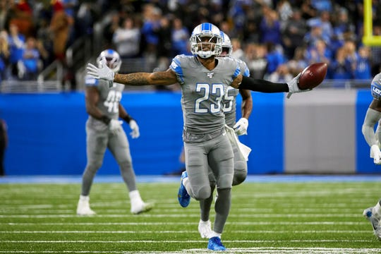 FILE - In this Nov. 28, 2019, file photo, Detroit Lions cornerback Darius Slay (23) celebrates an interception against the Chicago Bears during an NFL football game in Detroit. The Lions agreed to trade cornerback Darius Slay to the Philadelphia Eagles, ending the standout defensive back's seven-year stint in Detroit. Agent Drew Rosenhaus confirmed the trade Thursday, March 19, 2020, and that Slay has agreed to a three-year, $50 million extension with Philadelphia. (AP Photo/Rick Osentoski, File)