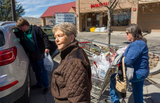 Gigi Neal, of Yerington, has her grocery supplies loaded into her car after shopping at Raley's Tuesday afternoon.