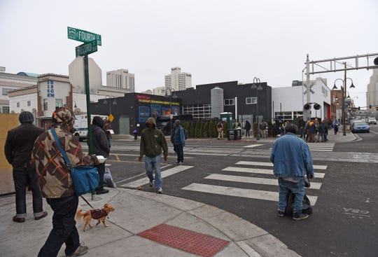 Homeless people gather aroung the corner of Fourth Street and Record Street near the Reno Sparks Gospel Mission on Wendesday March 18, 2020.