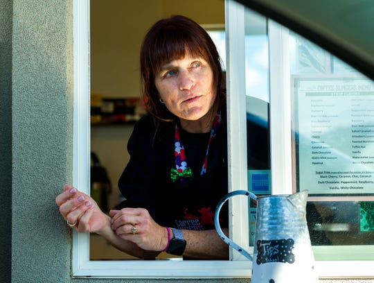 Rebecca Wellnitz, manager of Coffee Slingers, says the drive thru coffee shop will remain open to serve local customers.
