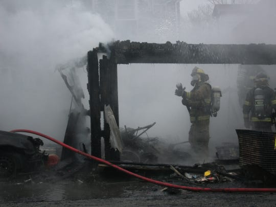 Firefighters spray water on a burning garage Thursday, March 19, 2020, in Hagerstown.
