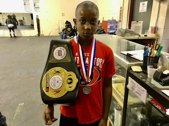 """Zah'Mere Williams, 10, of Rochester 58 School and his national Silver Gloves title belt. He trains at the Rochester Fight Factory. """""""
