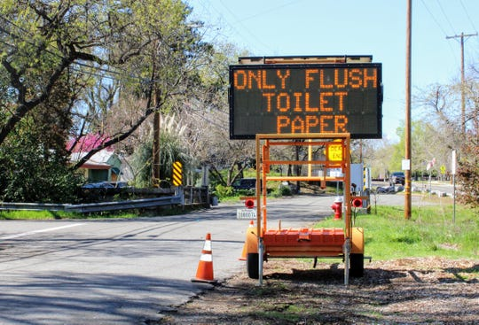 This electronic sign urging people not to flush items other than toilet paper stood at the corner of Smile Place and Russell Street in Redding on Thursday, March 19.
