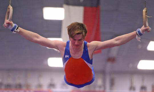 Titus Wright performs on the rings during a meet at San Angelo Central High School on Thursday, March 5, 2020.