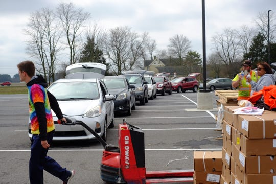 As cases of the novel coronavirus increase in Sussex County, 1,200 residents lined up for the Food Bank of Delaware's emergency drive-thru pantry on Thursday, March 19, 2020.