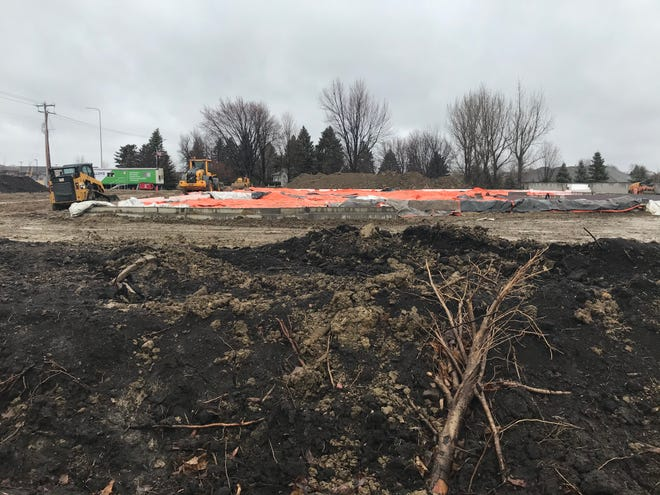 Machinery and tarps cover the future site of American Bank & Trust's newest Sioux Falls location along South Minnesota Avenue.