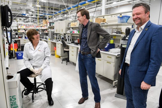 Lab director and cloning lab director Melanie Nichols speaks with U.S. Rep. Dusty Johnson and president and CEO Eddie Sullivan during a tour of the lab on Thursday, March 19, 2020 at SAB Biotherapeutics in Sioux Falls.