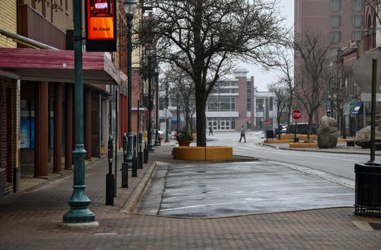 The streets are mostly empty along St. Germain Street just after noon Thursday, March 19, 2020, in downtown St. Cloud.