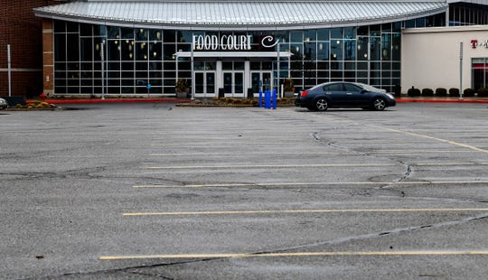 The parking lot at Crossroads Center near the food court entrance is mostly empty at about 1:00 p.m. Thursday, March 19, 2020.