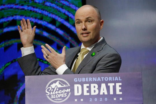 "FILE - In this Jan. 31, 2020, file photo, Utah Lt. Gov. Spencer Cox speaks during a debate for Utah's 2020 gubernatorial race, in Salt Lake City. Gubernatorial candidate Cox announced his running mate Thursday, March 19, 2020, as Utah Sen. Diedre Henderson. ""As we look at the problems that Utah is facing in the near future, and in the long term, I think we really need people in leadership who know how to work well with others,"" she said in a campaign video. ""That's what I've learned to do in the Utah state Senate."" (AP Photo/Rick Bowmer, File)"
