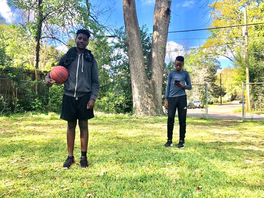 Ke'Mahr Dawkins and Ty'Shaun Powell play basketball at a local Tallahassee park during Leon County Schools spring break, 2020. Schools are officially shuttered due to the coronavirus through April 15.
