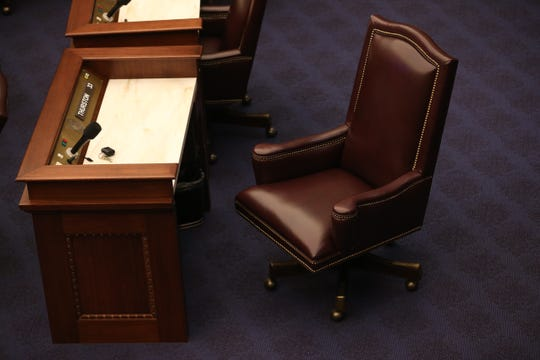 An entire row of desks sit vacant in the Senate chamber as some members of the legislature chose not to attend the last day of the 2020 legislative session at the Capitol amid the coronavirus pandemic Thursday, March 19, 2020.