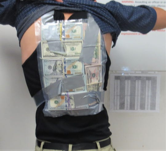 El Paso CBP officers seized more than $100,000 strapped to a young man at the Zaragoza border bridge on Tuesday, March 17, 2020.