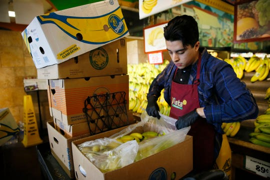 Vista Markets grocery stores in El Paso are hiring. Here, Diego Leyva restocks bananas March 19 at the Vista store at 2231 N. Zaragoza Road in far East El Paso.
