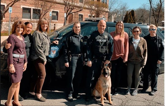 Clarkstown Officer Robert Reilly introduces K9 Yara, a 16-month-old German shepherd, with several of the department's female officers during National Women's Month in March 2020.