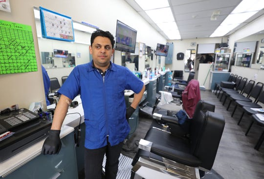 Artem Rafailov, the owner of the Park Avenue Barbers on Central Avenue in Hartsdale, talks about the decline in business, March 19, 2020.