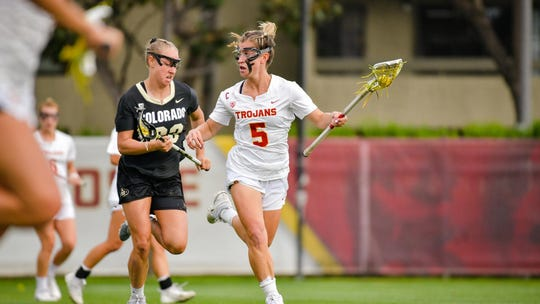USC women's lacrosse captain Emily Concialdi scans the field, as she tries to evade opposing defenders.