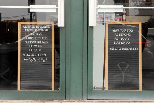 A closed sign posted at Knotz Hair Studio, one of the several businesses closed in New Rochelle, NY due to the coronavirus pandemic, March 19, 2020.