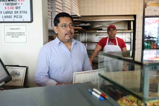 Daniel Santiago, the owner of the Villaggio Italiano pizza shop in The Dalewoods shopping center on Central Avenue in Hartsdale, talks about the decline in business, March 19, 2020.