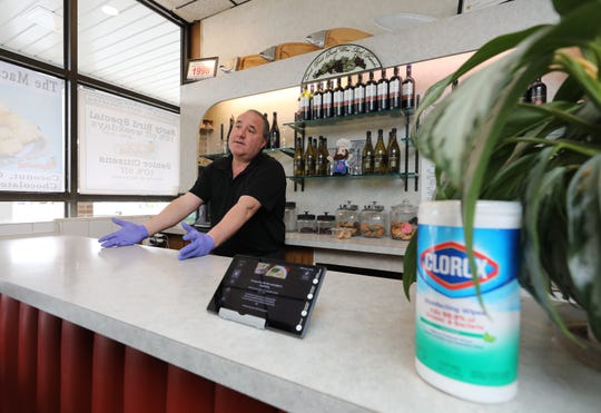 With a box of Clorox wipes at the ready, Frank Marto, the general manager at Epstein's Kosher Deli in The Dalewoods shopping center on Central Avenue in Hartsdale, talks about the decline in business, March 19, 2020.