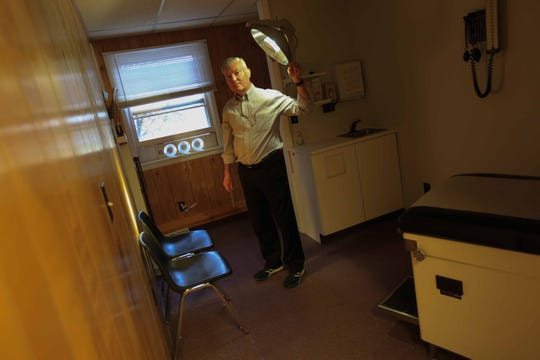 Dr. William Funk, a primary care doctor in Newark, is taking extra precautions with treating his patients during the coronavirus outbreak by having a designated treatment room for patients that might be exhibiting signs of the virus. A fan placed in a window circulated fresh air into the room.