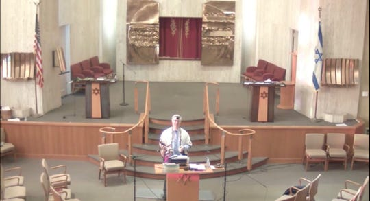This still shows Rabbi Michael S. Beals of Congregation Beth Shalom in Wilmington livestreaming one of his daily lessons.
