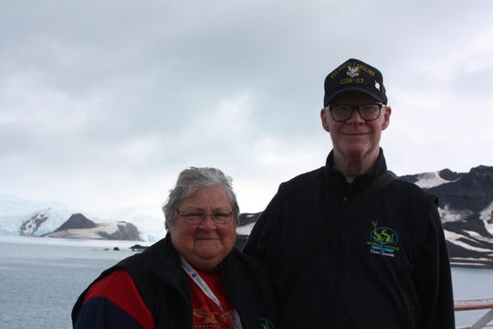 Sandi and Chris Mulligan with Antarctica in the background.