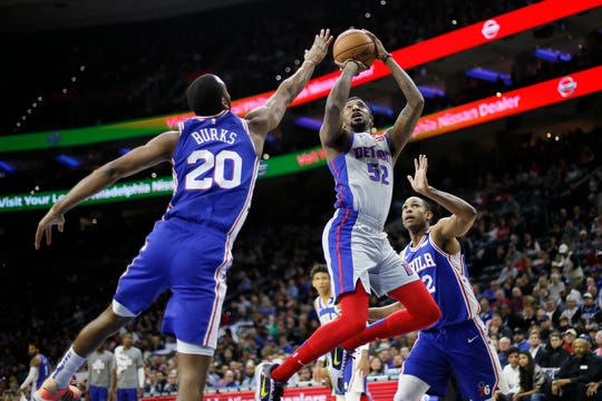 Detroit Pistons' Jordan McRae (52) goes up for a shot between Philadelphia 76ers' Al Horford (42) and Alec Burks (20) during the first half of an NBA basketball game, Wednesday, March 11, 2020, in Philadelphia. (AP Photo/Matt Slocum)