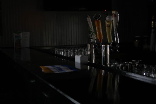 Rockford Tavern in Wilmington sits empty, the stage stacked with cases of beer scheduled to be returned to the distributer on Thursday.