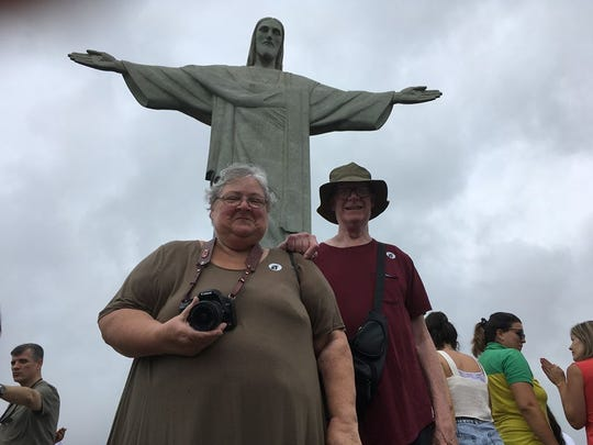 Sandi and Christ Mulligan pose near the Christ statue at Corcovado, Brazil.
