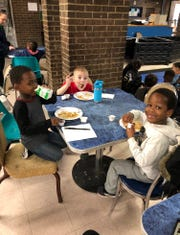 Children have breakfast at the Fraim Boys and Girls Club in Wilmington Wednesday courtesy of a donor who paid for a local restaurant to provide the meal.